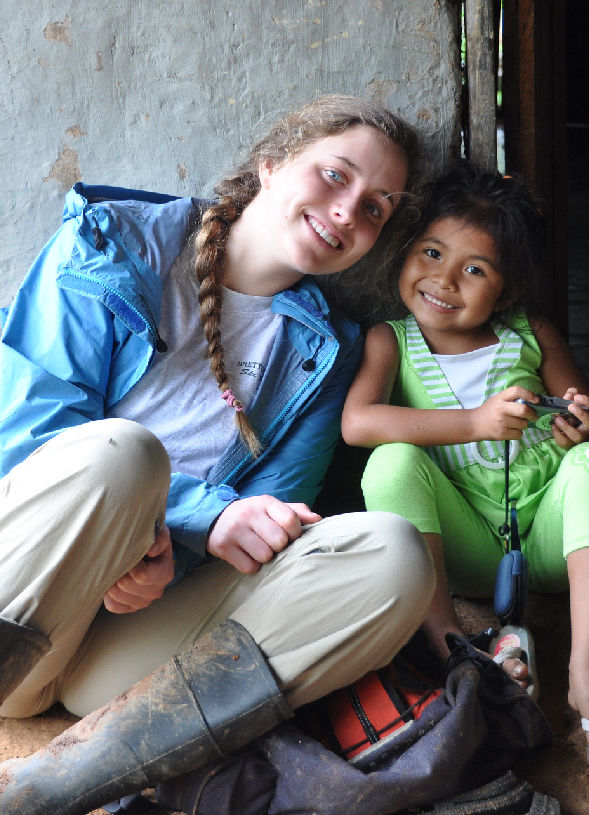New friends, a farmers daughter and volunteer, smile in Central America