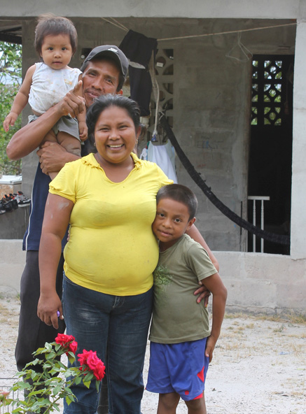 Happy farming family smiling in Penonome, Panama