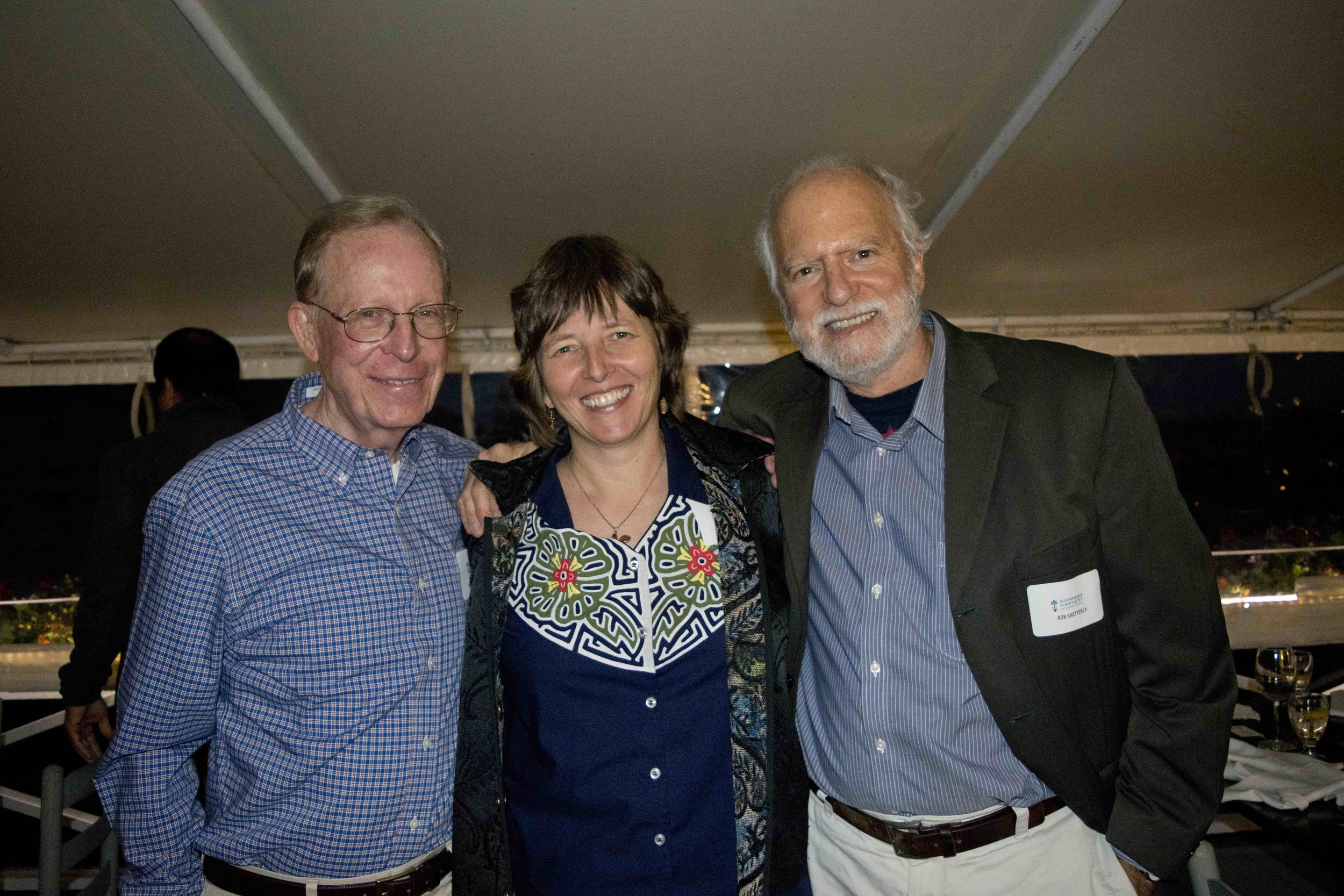 Steve Richards (Sustainable Harvest International Board Chair), Florence Reed (Sustainable Harvest International Founder + President), and Robert Shetterly (artist and activist)