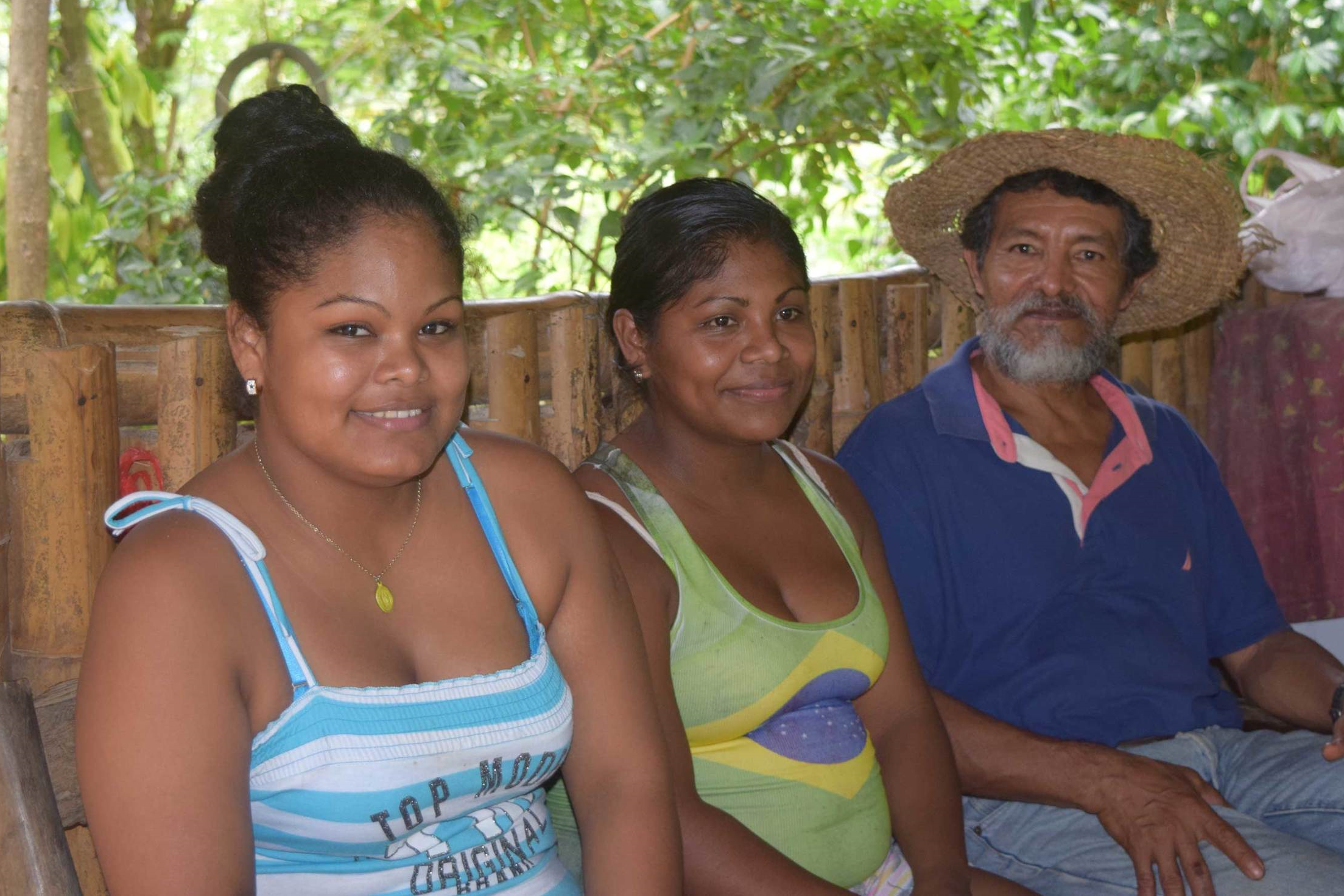Joaquín sits in the kitchen with his daughters Florinda and Adelen. - photo by Michele Christle