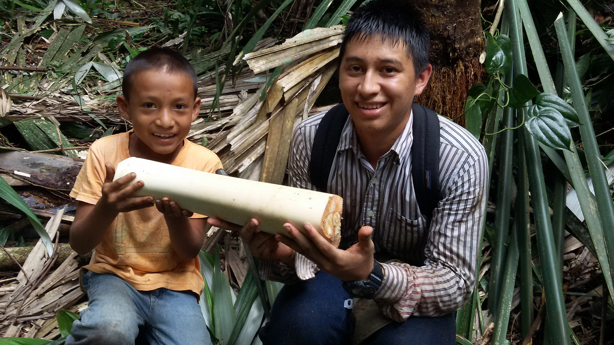 Alexis and Frehilio (Alfonso's son) holding a giant palm heart