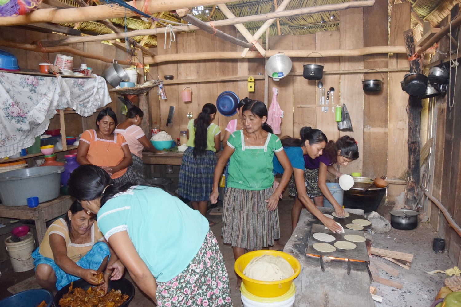 In the busy kitchen of Luciya Coc, community members help make a mountain of tortillas to feed everyone who helps build the new home - p  hoto by Robin McCarthy