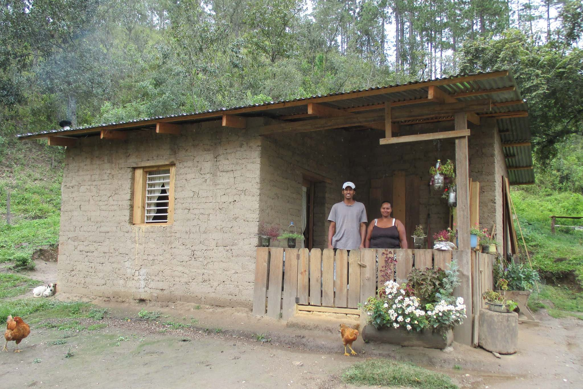 Carlos and Sonia Sophia u  sed funds generated from their vegetable garden to finish building their home.- photo by Franklin Paz