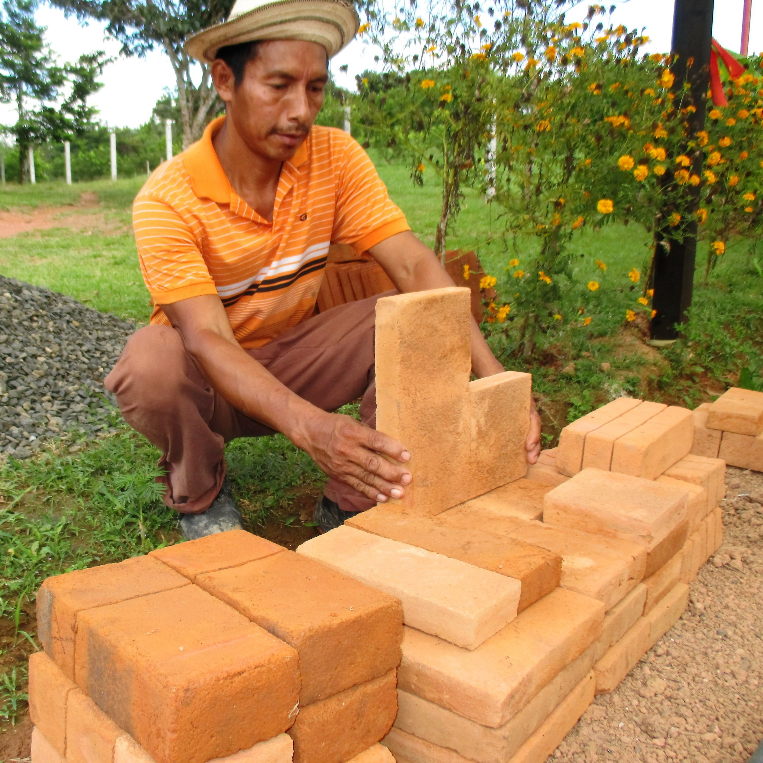 Rafael prepares materials for a new wood-conserving stove. - photo by Daysbeth   López