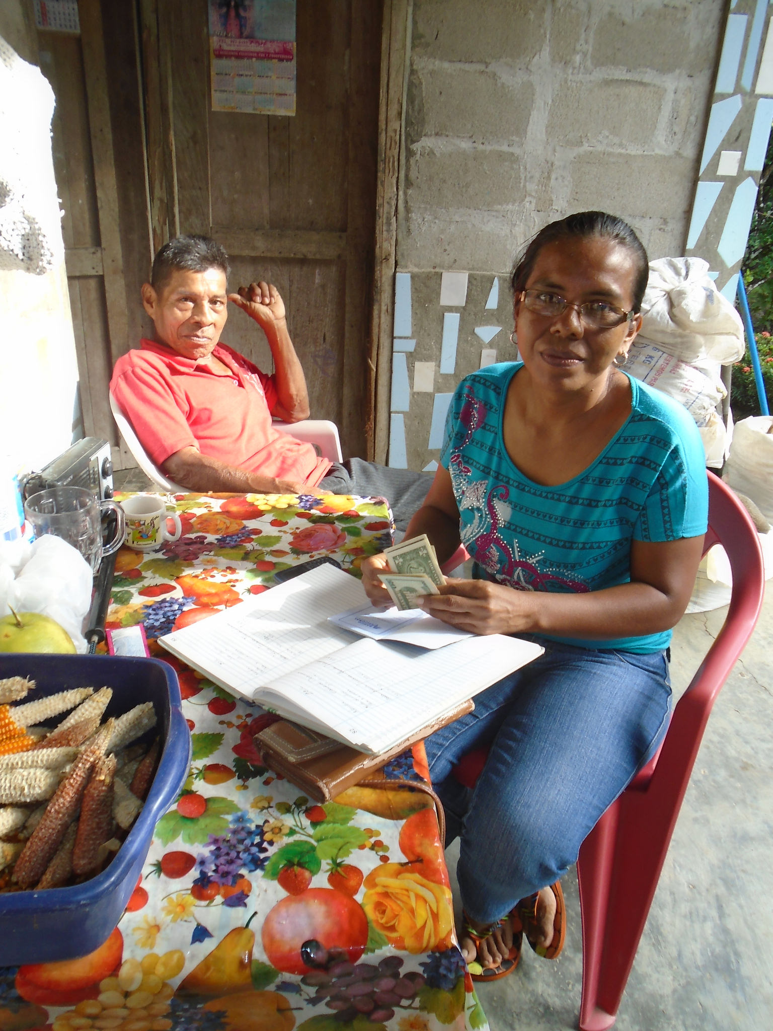 Nancy keeps meticulous notes to track the bank's loans. - photo by Dayra Julio