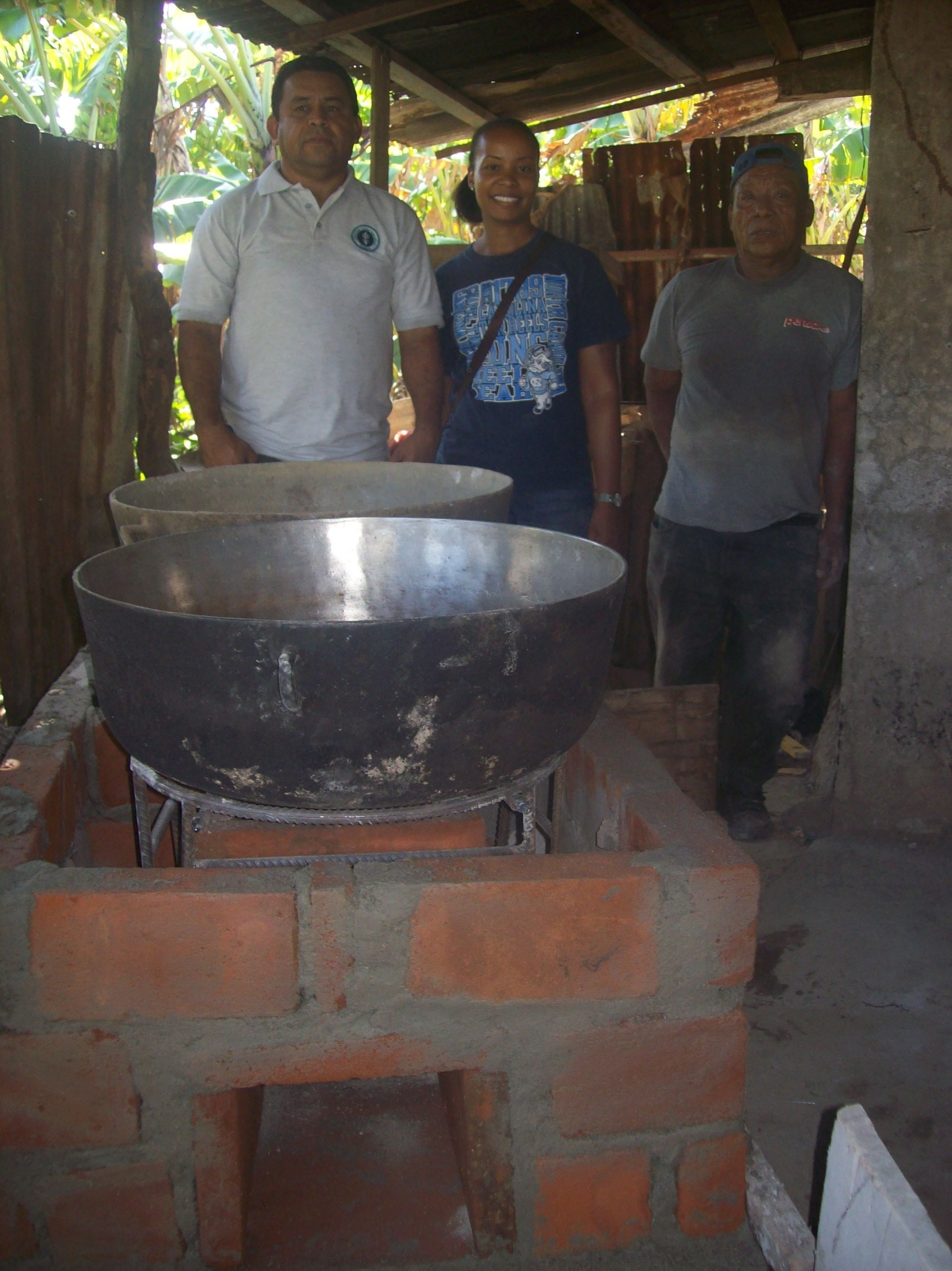 LaTaurus, Trujillo, and Rogelio stand beside the first wood-conserving stove in La Pedregosa.