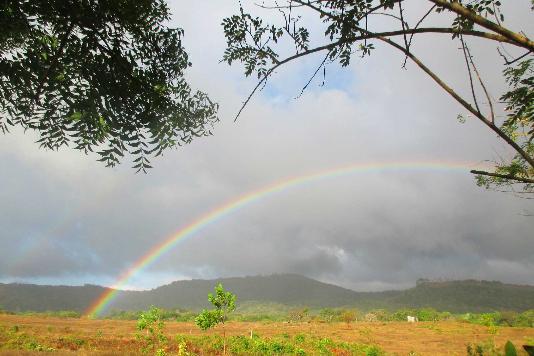 A rainbow brightens the view from participant Reina Cedeño's home in La Candelaria, Panama