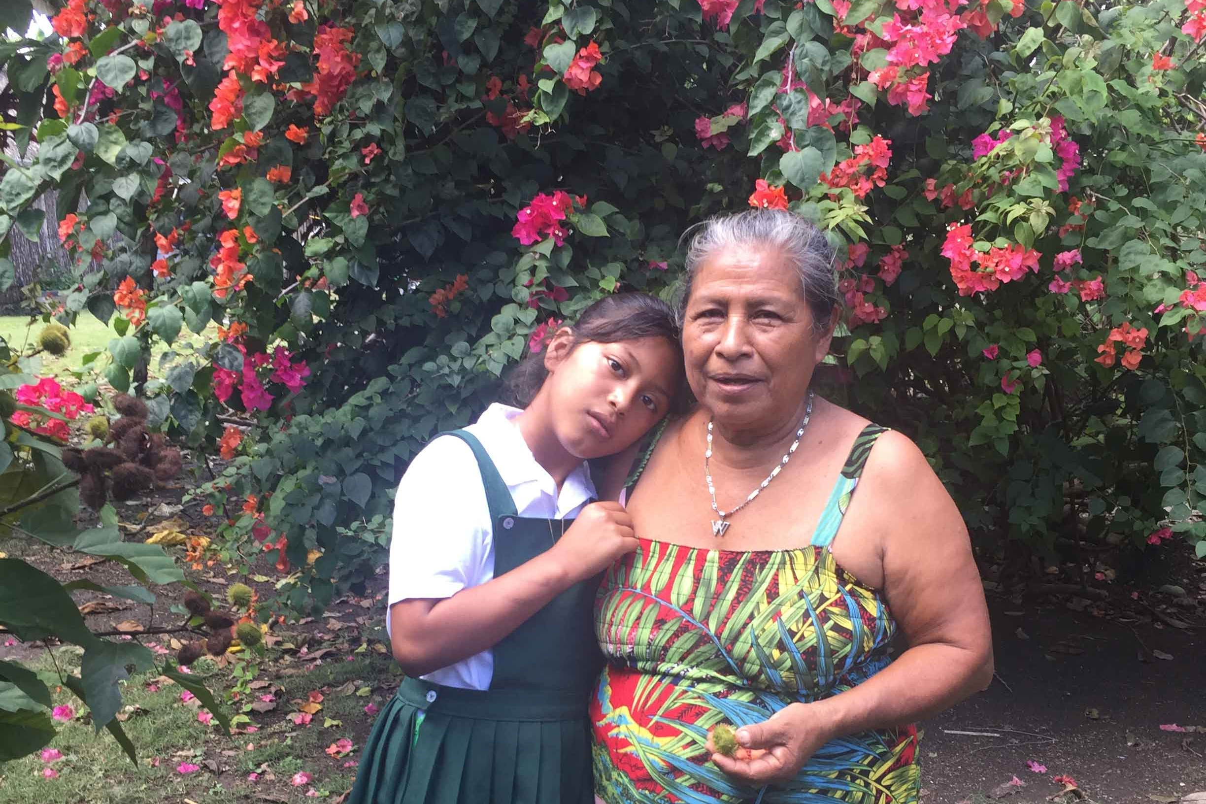 Josefa (R) had to leave school after third grade to help her widowed mother. She hopes that her granddaughter, Kathia (L), who is now in elementary school, will have more access to education than she did.