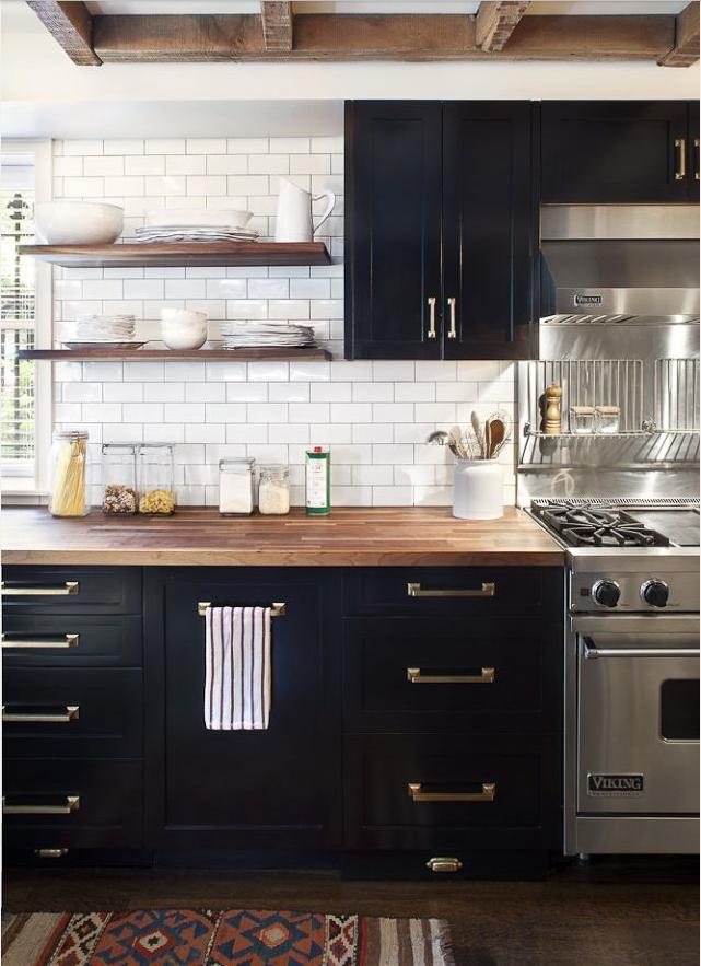 black_painted_shaker_cabinets_vintage_subway_tile_kitchen.png