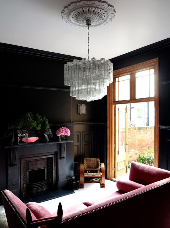 black_interior_walls_with_70's_chandelier.png