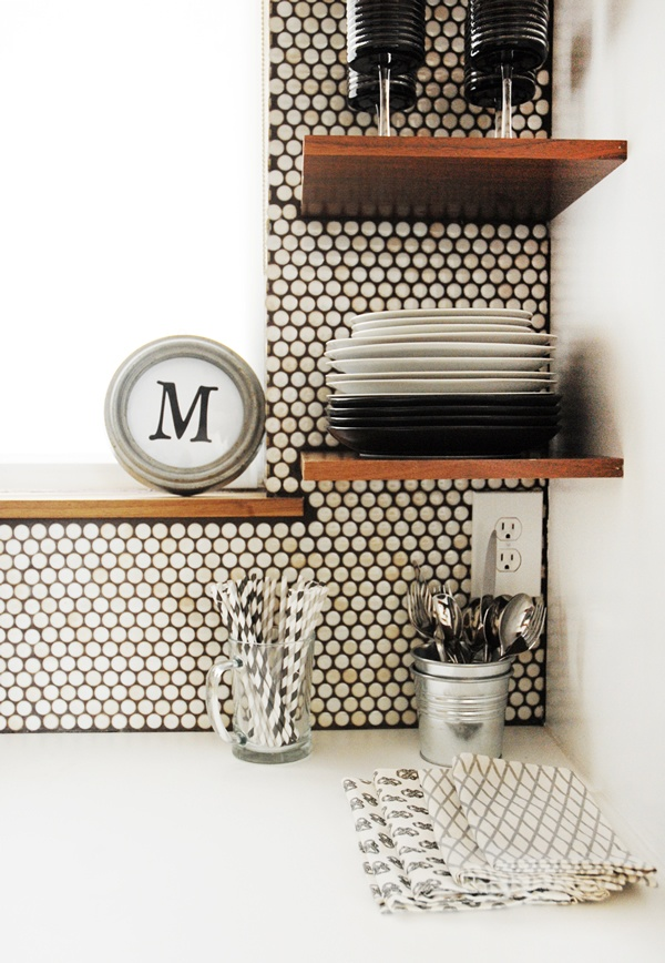 penny round tiles with walnut floating shelves.jpg