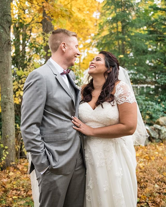 What happens when you take a travel and dog-loving Thai lady and ginger gent who have a beautiful years long love story and who decide to get married during the most beautiful time of year in New England? These photos, duh! 😁 . Andrea and Scott's wedding was just last week! Not going to lie, I was a little nervous to see how the day would flow considering 1) The weather was rainy/misty and the ground was muddy 2) A+S wanted to squeeze in a first look before their catholic ceremony but were worried about guests seeing them 3) It was daylight savings time, so almost all of their portrait time was going to take place as the sun was setting (but on a cloudy day, which meant no pretty sunset). . But guess what? I made a plan for all of this! 💪🏼 1) I made sure that between the couple and I, we had enough clear umbrellas for the whole wedding party in case it rained more during their portrait time 🌂 2) Since the couple had a bus to take them to the church for their ceremony, Andrea was able to hide in the bus, which dropped her off right next to their first look spot, keeping early guests from seeing her 🚍 3) I busted out my lighting gear and got some gorgeous lit portraits of A+S after the sun went down. Just because the sunlight was gone didn't mean we couldn't take any more photos! 📷 Day seized!