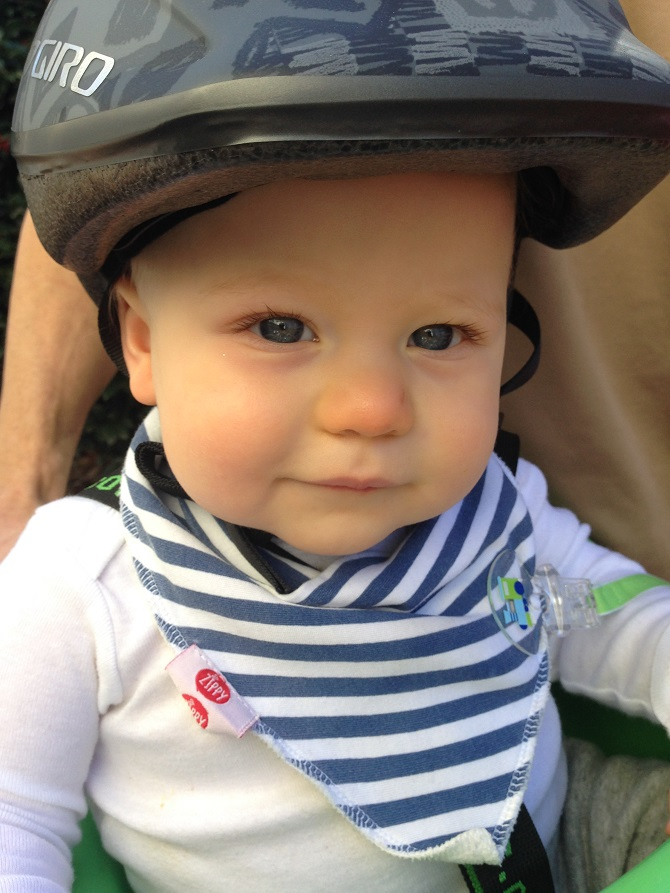 We bought a bike carrier and helmet for you little one! You cried the first time we tried your helmet on, but loved riding around the neighborhood on dad's bike. You squealed every time that I sped past and babbled about the entire ride.
