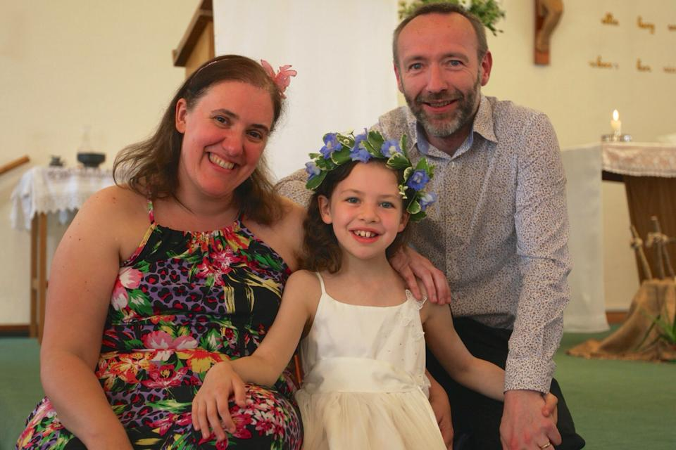 Sarah and David Beresford with their beautiful daughter Molly at her First Holy Communion.