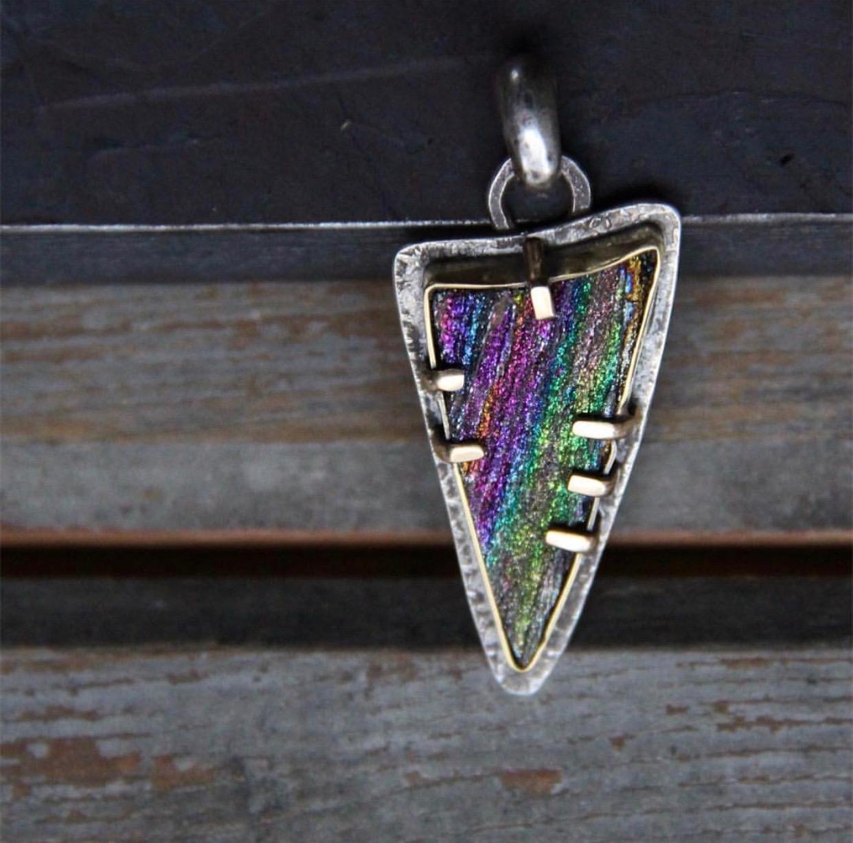 "SUSAN FAUMAN - ""Rainbow Slice"", natural rainbow hematite, sterling silver, solid 18K gold$900 SOLD"