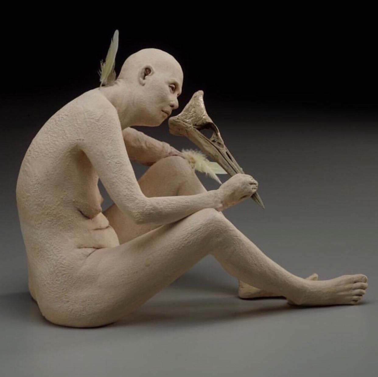 "SUSANNAH ZUCKER - ""Mask"", ceramic, feathers, bird skull, silver leaf 20179"" x 7"" x 12""$3,000"