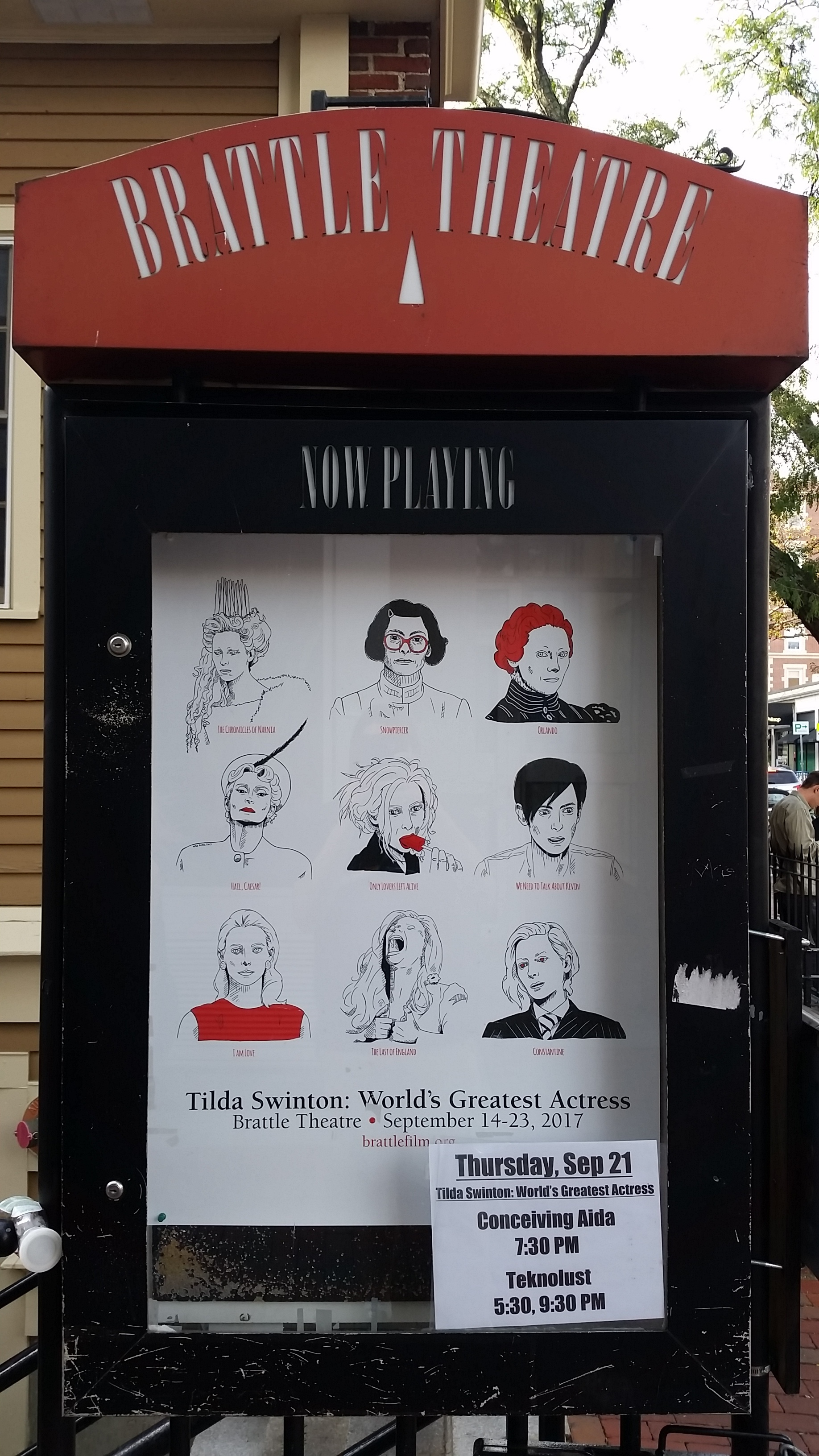 Outdoor sign showcasing the Tilda Swinton retrospective.