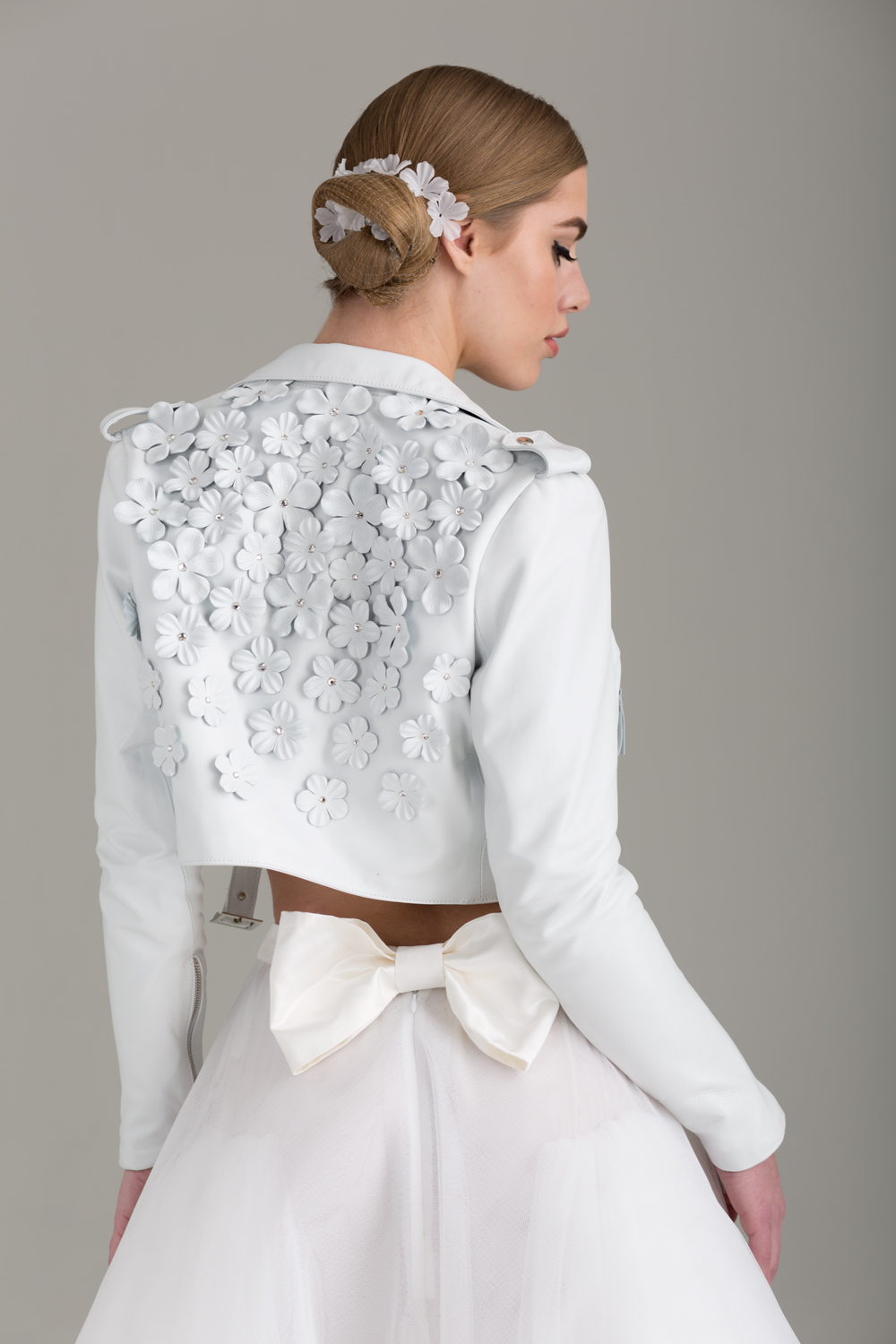 NKB17-84001    Nathalie Cropped Lambskin Leather MC Jacket Embellished w/ Hand-Made Leather Flowers & Swarovski Crystals;  NKB17-81002  Apoidea Satin and Mesh Crop Top &  NKB17-83005  Christina White Tulle Mesh A-line Skirt