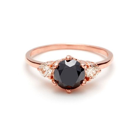 black diamond rose gold champagne diamond side stones engagement ring on it side