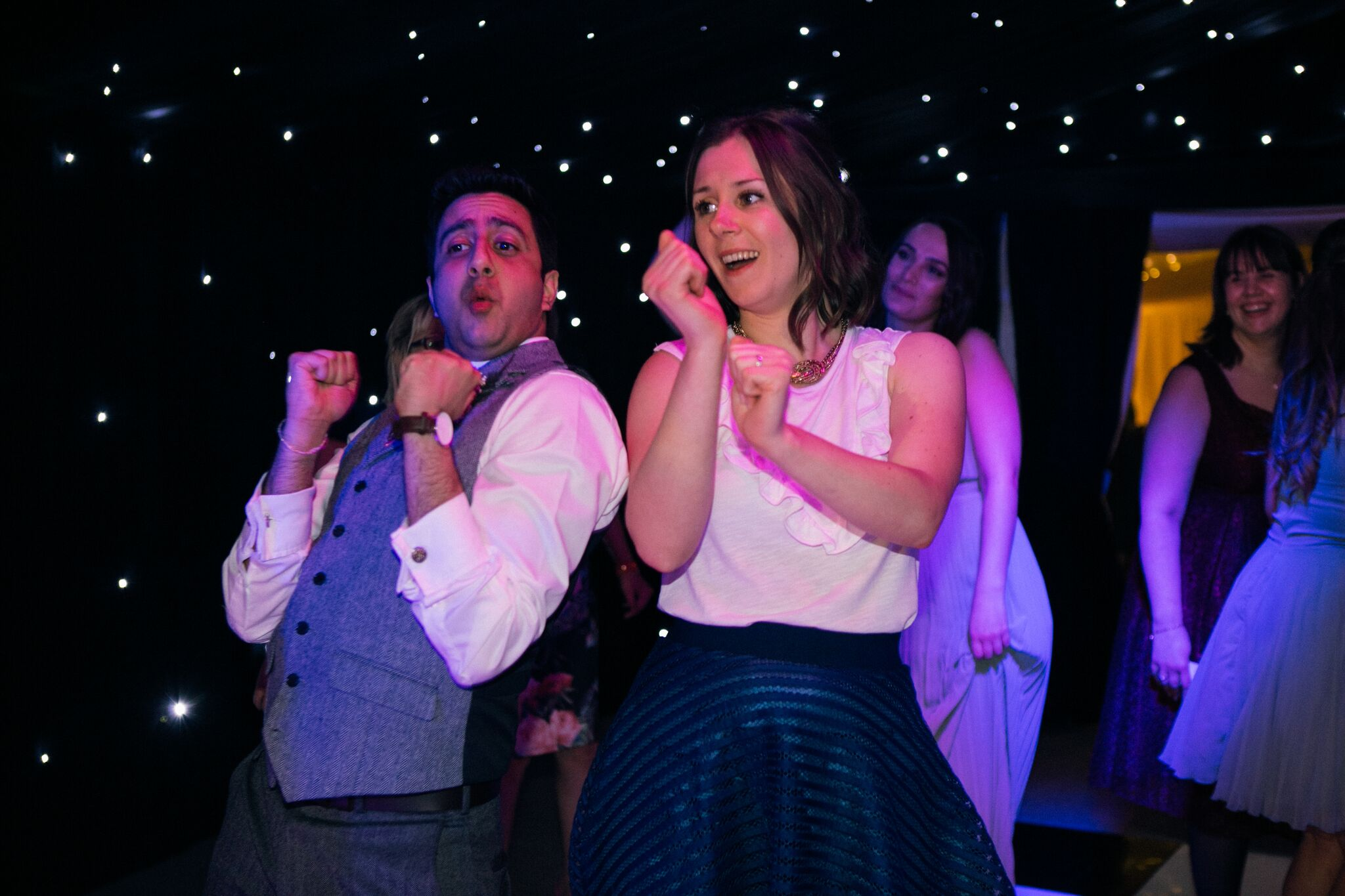 Guests partying on the dance floor with the DJ