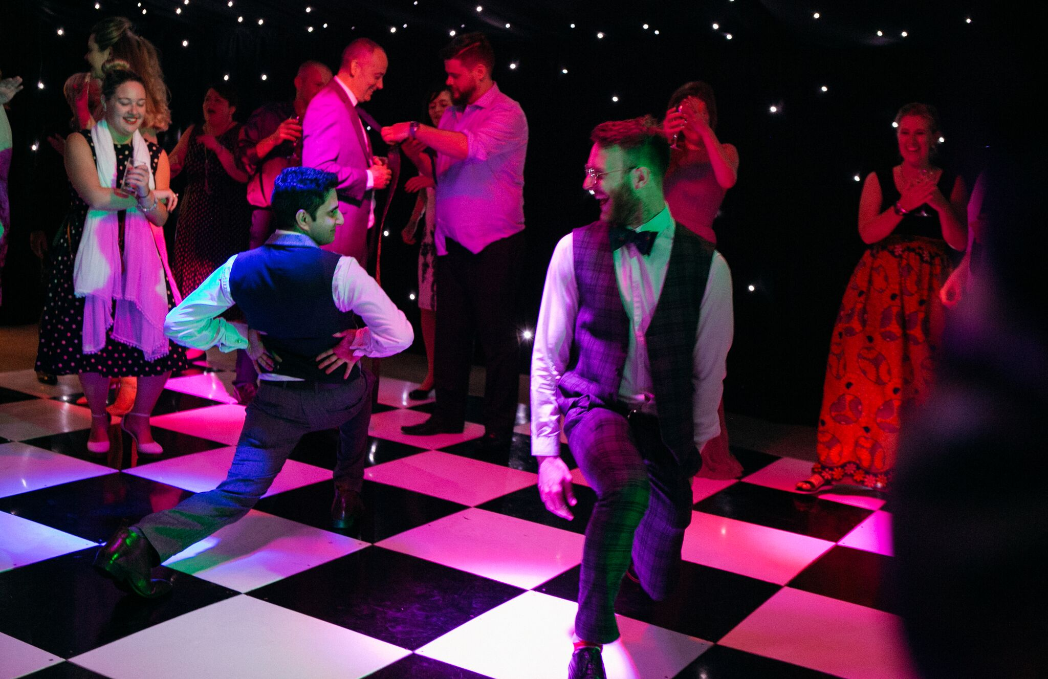 Guests dancing on the dance floor at Jen and Tom's wedding