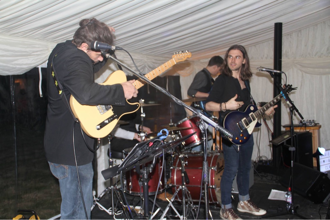 Hertfordshire wedding indie rock party band for hire setting up