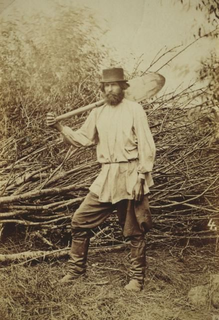 19th Century Russian serf posing with spade.