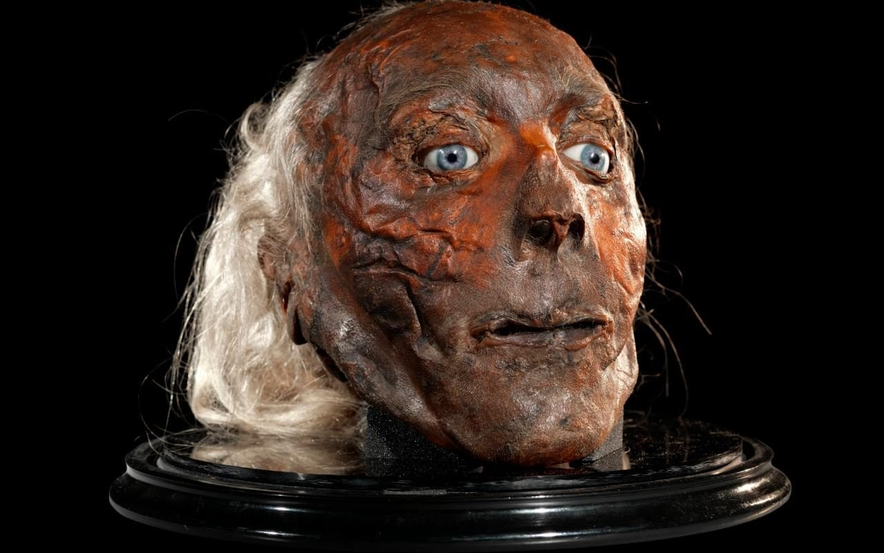 Jeremy Bentham's taxidermied head adordned with his coveted glass eyeballs.