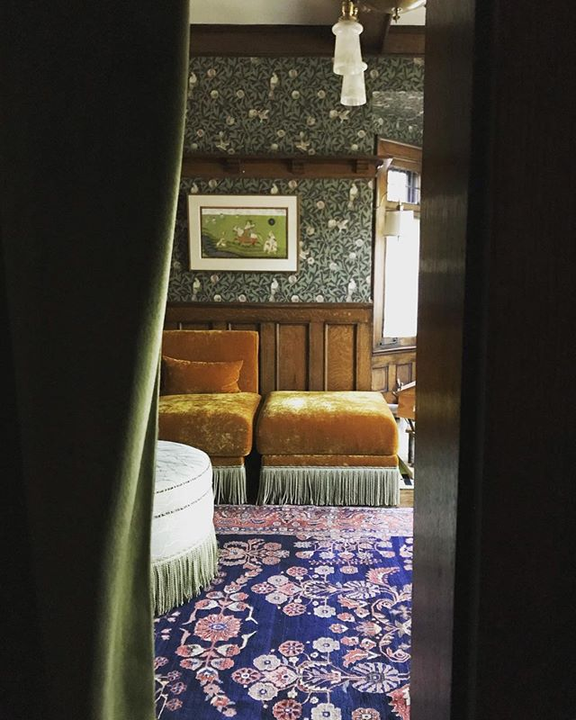 Through the portiere: sneak peek at an almost complete drawing room... 🧡💙💚❤️ . . . . . . . . #torontodesigner #torontointeriordesigner #torontointeriordesign #portiere #ottoman #bullionfringe #customottoman #customsofa #englishartsandcrafts #artsandcraftshome #periodhome #wallpaper #velvetsofa