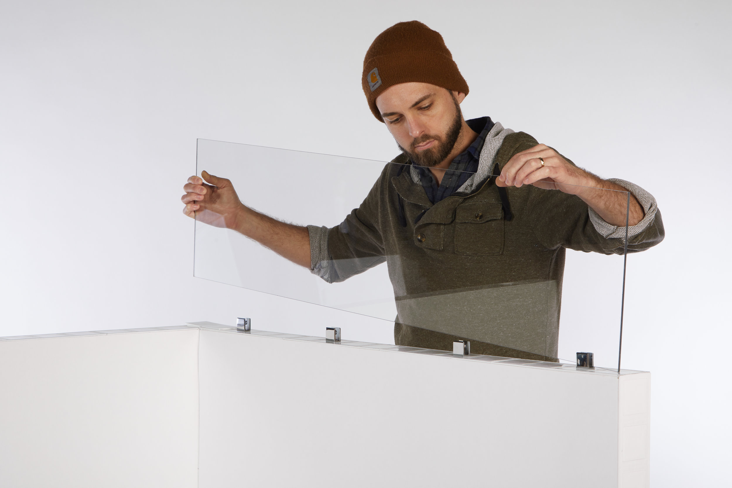 Inserting a clear window panel into Mounting Caps