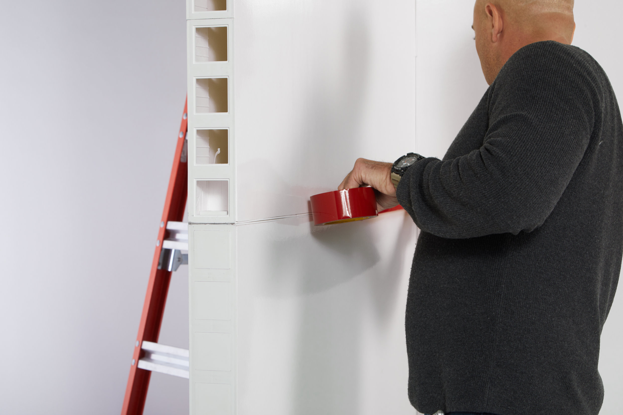 Placing construction seaming tape over seams before installing wallpaper (recommended).