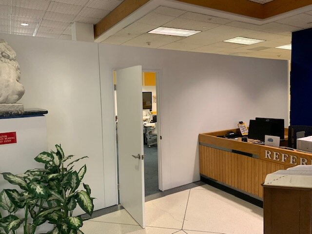 Divide reception and front desk areas to maintain social distancing walls from staff and visitors.