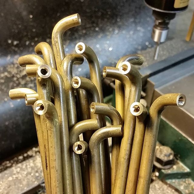 Summertime bouquet of brass pulls. Simple concept but tricky as the simple ones often are... required a unique order of operations and custom tooling for the Di-acro bender. All made in house.  #customhardware #brass #brasspulls #bentbrass #customfurniture #machined #diacrobender #madeinnewyork #metalworking #metalwork #drawerpulls #doorpulls