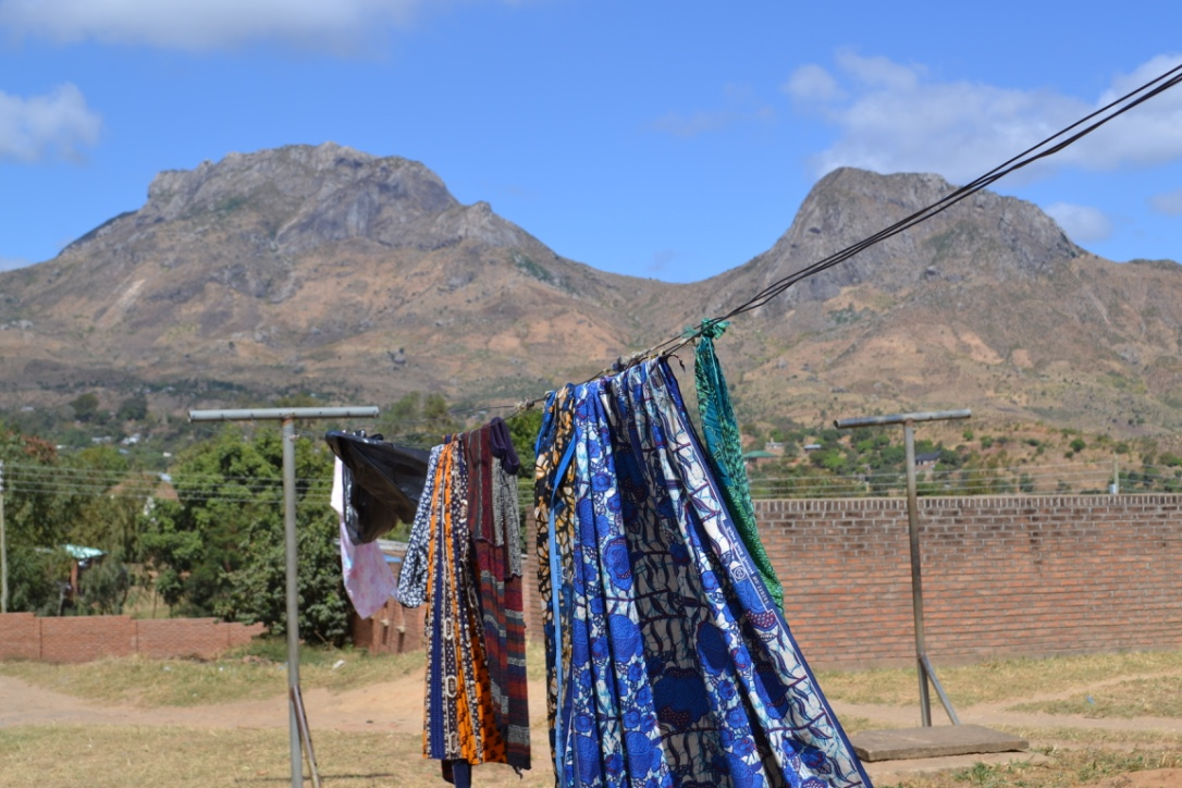 In the beautiful district of Blantyre, Andrea took this photo of cloths blowing in the wind. These were brought by pregnant women to the clinic to use while giving birth. Women often have to bring all of the supplies, including sheets, to the clinic.