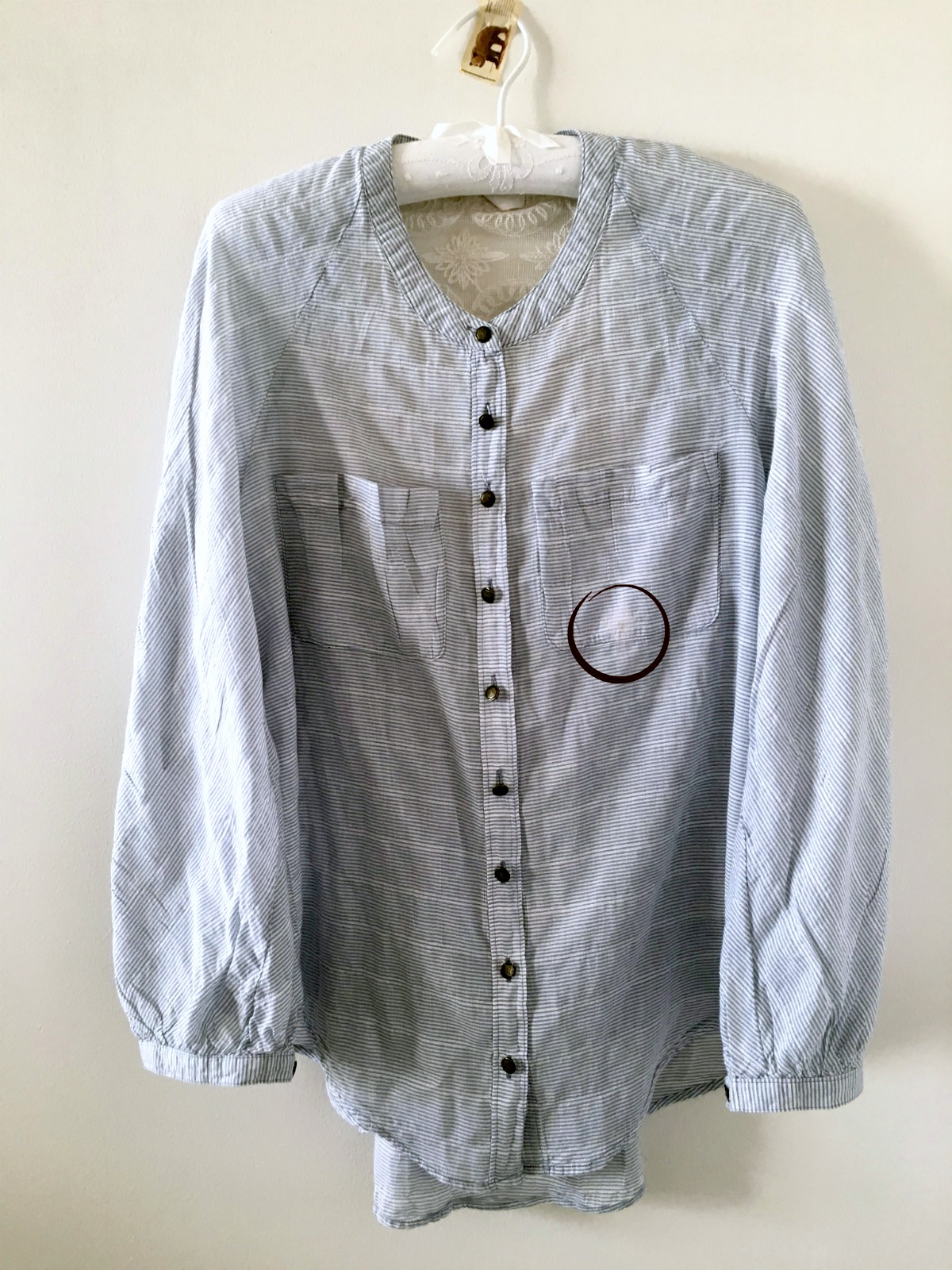 Shirt with stained pocket.