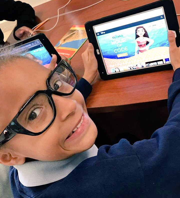 A student at IPS School #51 is excited to start the Moana Hour of Code activity.