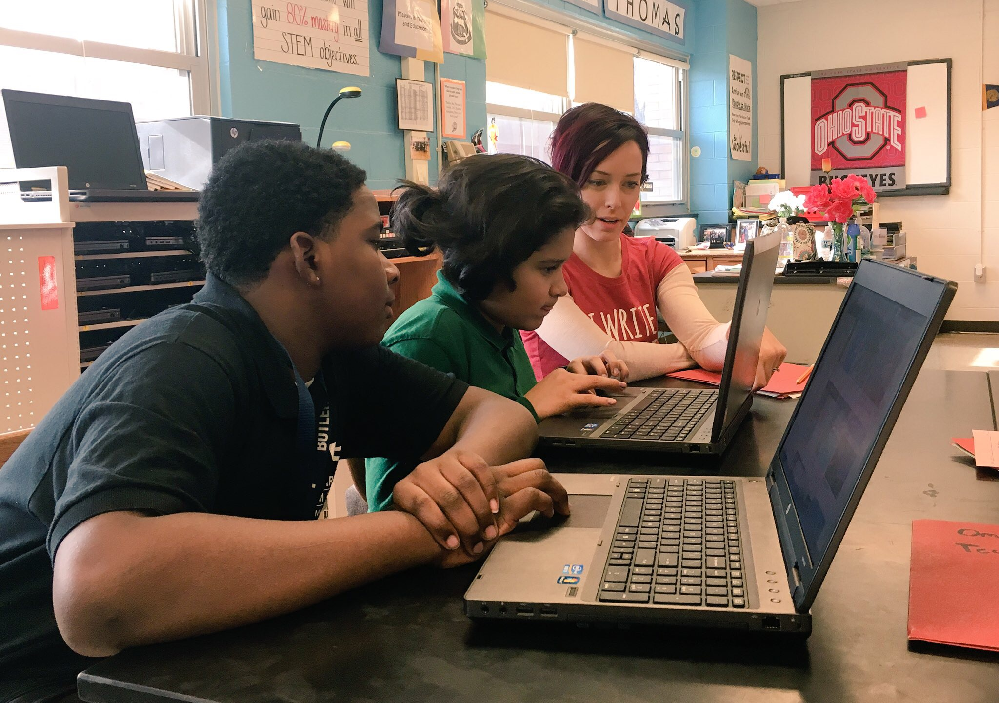 Lindsay Siovaila, co-founder of Girl Develop It - Indianapolis, works with students on an Hour of Code activity.