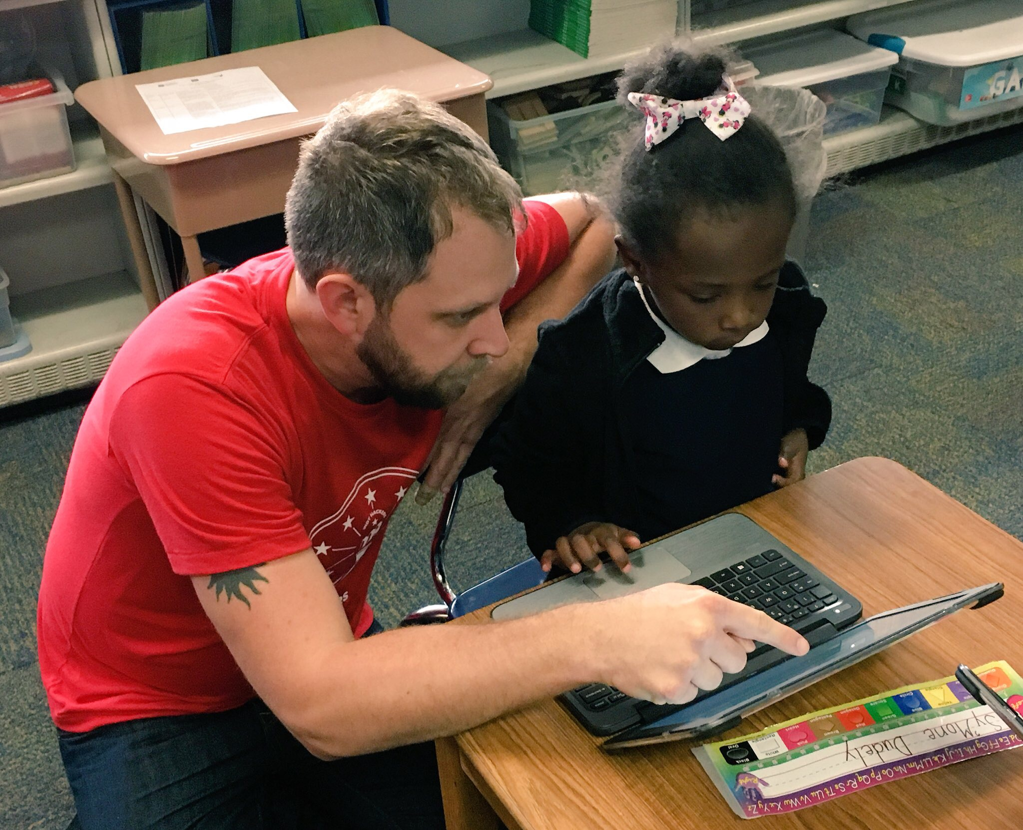 TPF4Y board member and DeveloperTown employee Jon Nolen works with a student at IPS School #55.