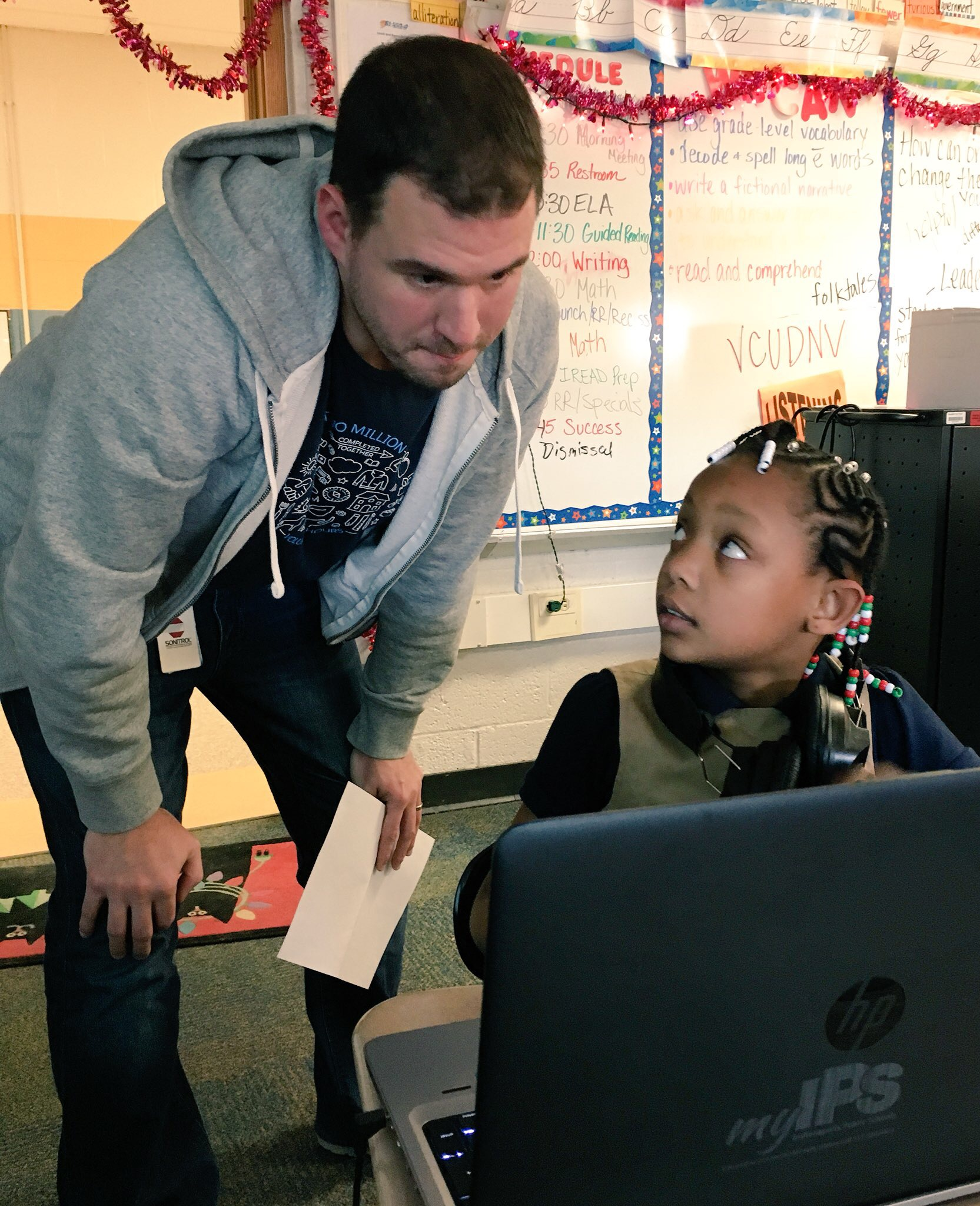Salesforce employee Will Brooks answers a question for a student.