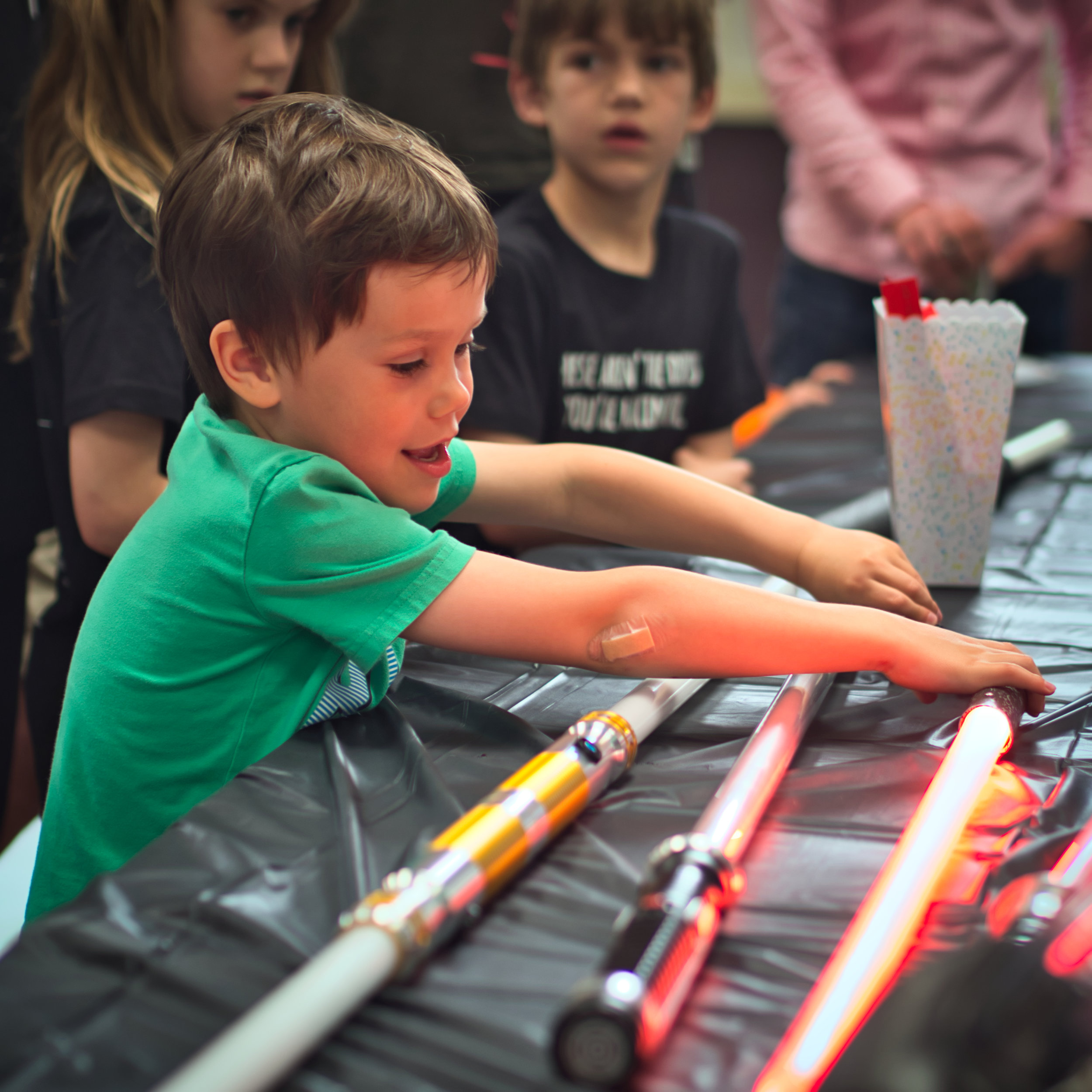 Checking out the lightsabers brought in by the Indy Lightsaber Academy