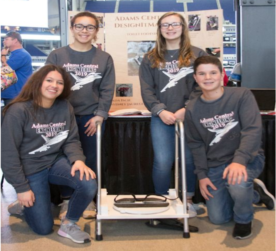 8th graders from Adams Central Middle School in Monroe, Indiana, pose with their project: Toilet Transfer, which received the Judges Top Award.