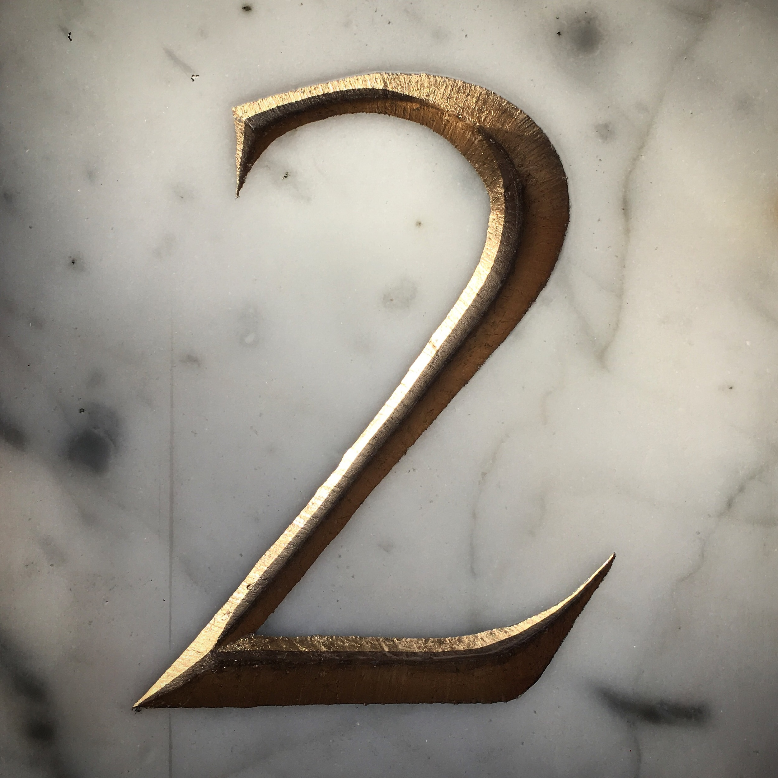 Roman Numeral 2 carved in Italian Carrara Marble & Gilded with 23ct Gold leaf.
