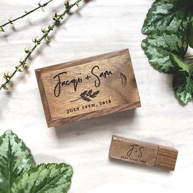 A wedding favorite - Walnut engraved USB box with botanic logo and hand-lettering to store those priceless videos and photos.⠀⠀ .⠀ I hope everyone had a wonderful New Years! I snuck away to a cabin in the mountains for a long and much needed rest from work, social media and stress in general. Now that life is back in full throttle, I'm excited to announce that it is official - I am relocating back home to NYC next month!⠀ .⠀ I'll be continuing my couch-surfing work/job hunting stay in the city in Jan - returning to Rochester in Feb to pack up the house and say my goodbyes.⠀ .⠀ I know this last month and a half is going to be a hard one - I had to say goodbye to my husband on New Years Day for the next 5+ weeks apart! 😰 We also have to find an apartment, and I still need to land a full time job. But I'm taking it one day at a time. Let's hope it flies by so I can stop this living away from him thing. It's not easy being hundreds of miles away from my best friend and life partner, but thankfully there's FaceTime!⠀ .⠀ Packaging curation and logo design by Helicon Paper Co. for @mangotreedocs. 📷@heliconphoto. Box & USB provided by @modernalbumdesigns .⠀⠀ .⠀⠀ .⠀⠀ .⠀⠀ .⠀⠀ #packagingdesign #weddinglogo #walnutusb #weddingvideography #weddingusb #weddingusbpackages #heliconpaper