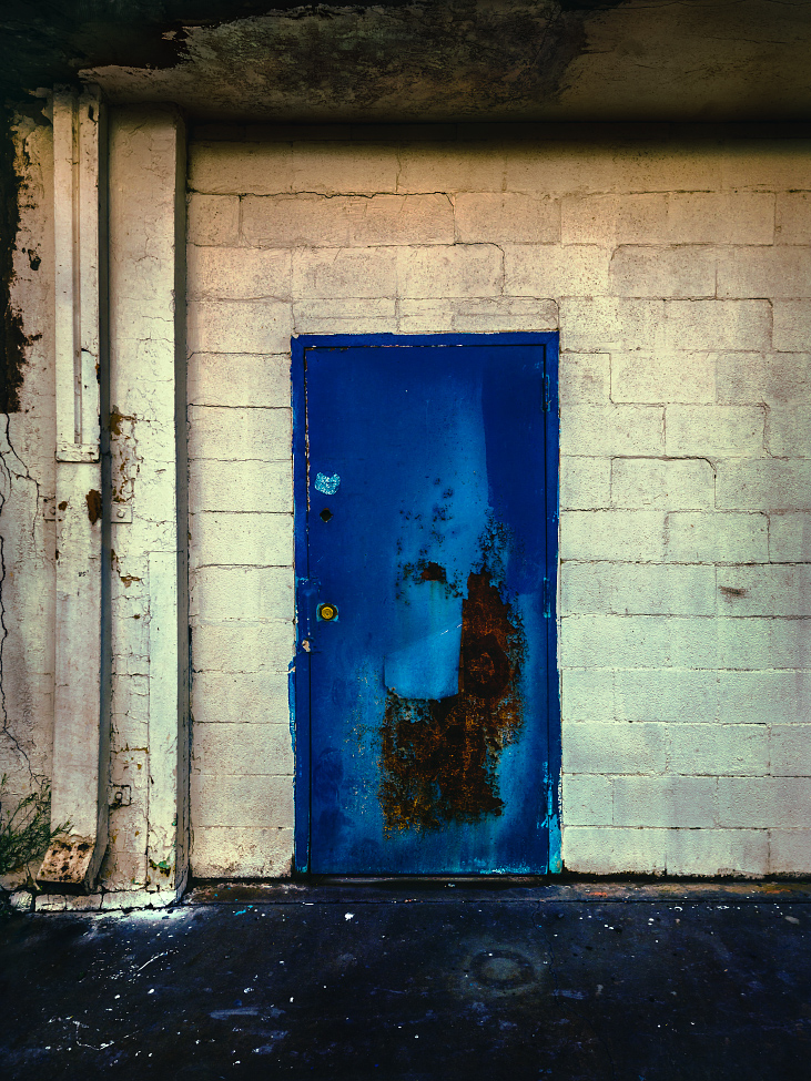 |#24|  B'dazzled Blue   Cinder-block build, outdated drainage system. Pitted and rusted lower quadrant. Over-sized spray-painted Cheerio.