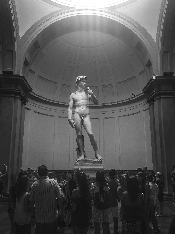 "The usual crowd around Michelangelo's ""David"" ."