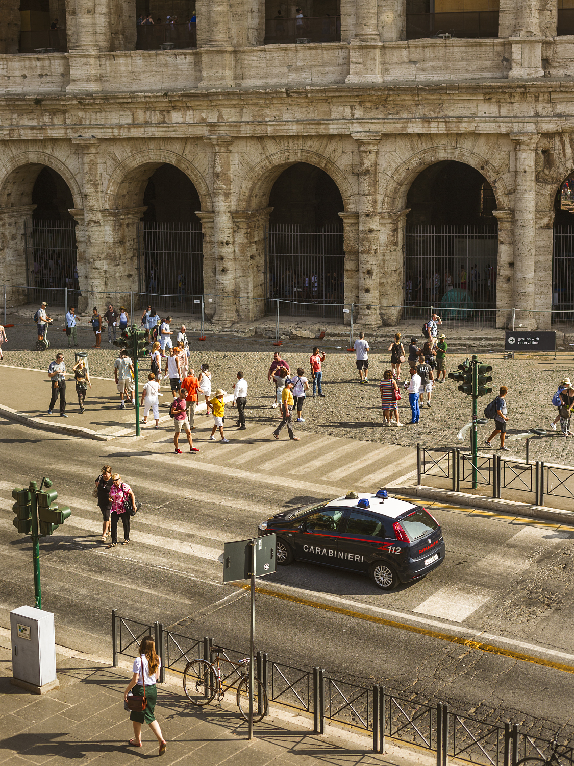 Busy crosswalk at the Colosseum.