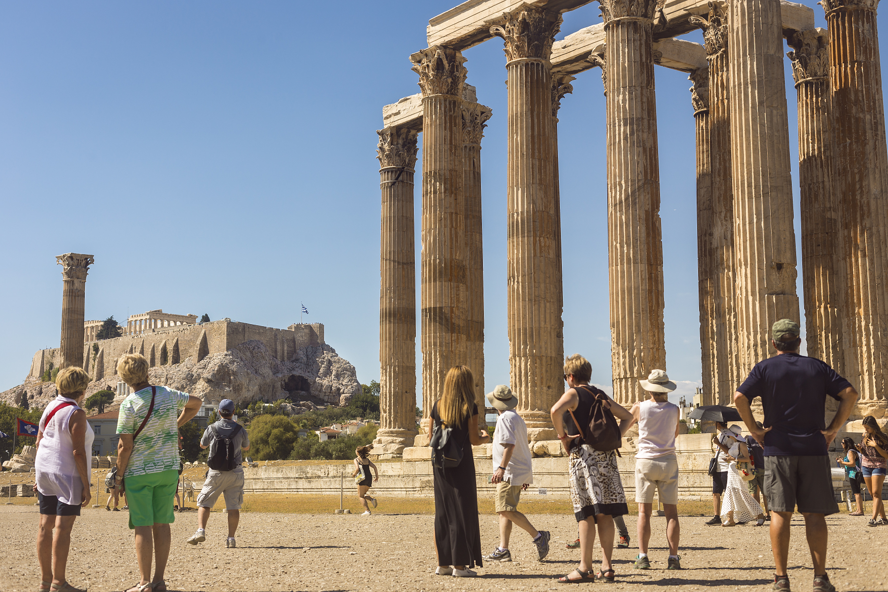 Tourists and locals taking in the  Temple of Olympian Zeus .
