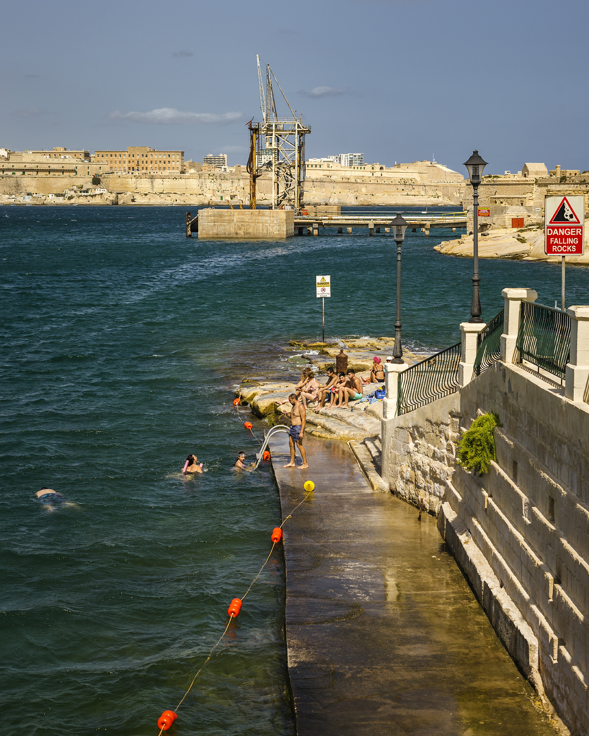 Maltese locals swimming in  The Grand Harbour .