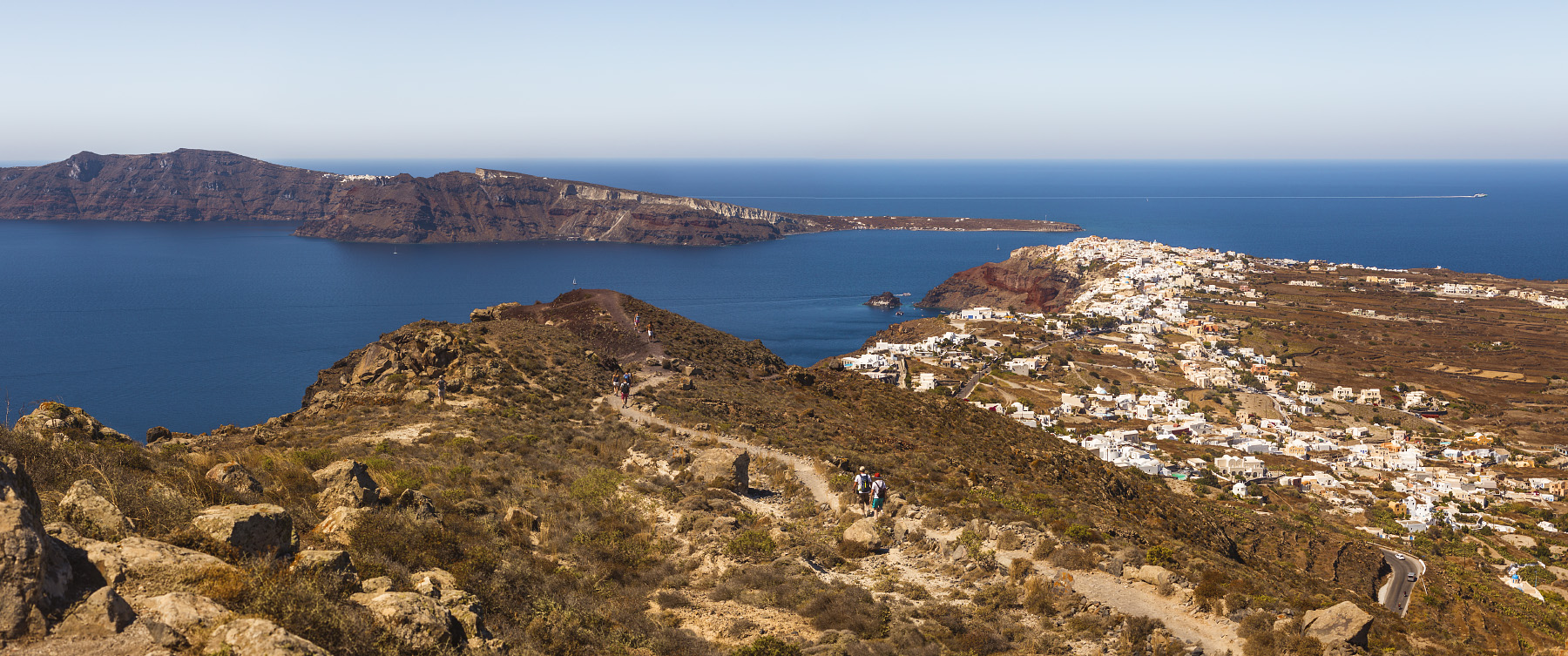 Almost at the North end of Santorini. The town of Oia is on the right, island Thirasia on the left.