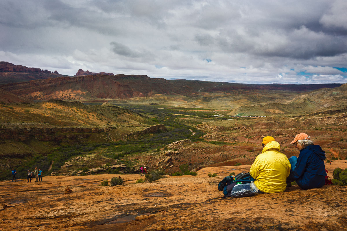 A pair of hikers taking a break along  Delicate Arch Trail .